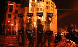Riot policemen stand guard in Istanbul's Taksim square.