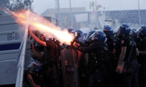 epa03740709 Turkish riot police use tear gas to disperse protestors during clashes at Taksim Square.