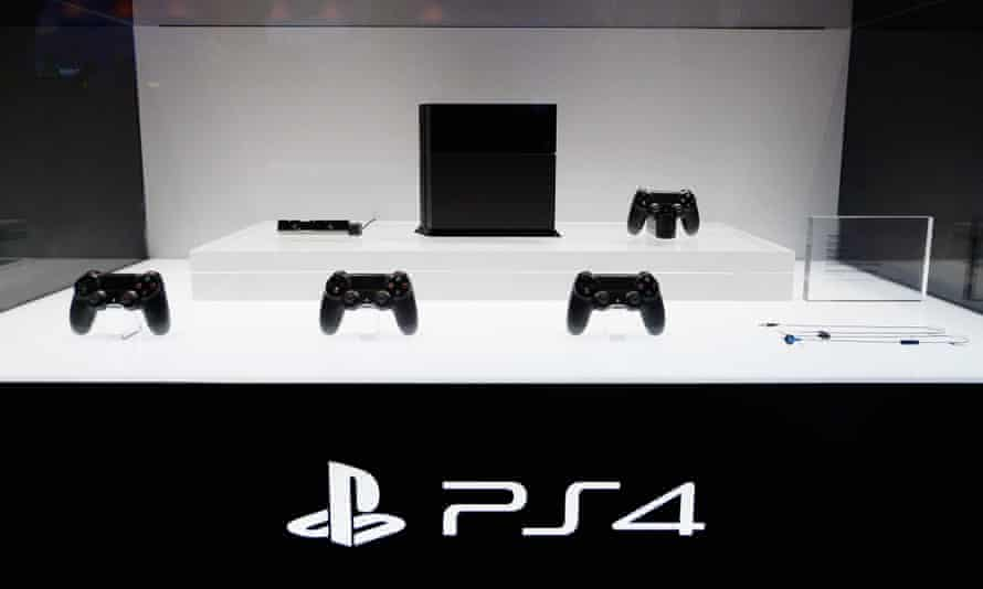 A Playstation 4 and its controllers on display at the Sony Playstation E3 2013 booth at the Los Angeles Convention Center.