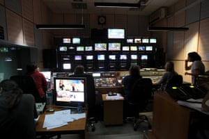 Employees of the Greece state broadcaster ERT keep on working in the control room early morning at the television station's headquarters in Agia Paraskevi after the government announced ERT's closure as of 11 June night, in Athens, Greece, on 12 June 2013.
