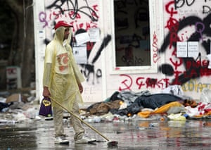 Turkey update: An activist cleans at Gezi Park following a night of continued clashes