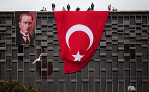 Turkey update: Officials hang a giant Turkish flag and a portrait of Mustafa Kemal Ataturk