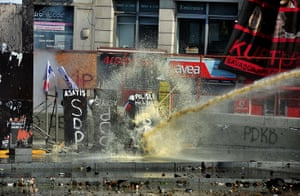 Turkey update: Protesters try to resist to the riot police's water cannon in Taksim square