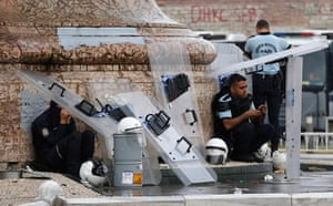 Turkey update: Riot police rest at Taksim square after overnight protests