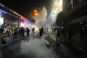 Turkey update: A man throws back a tear gas canister