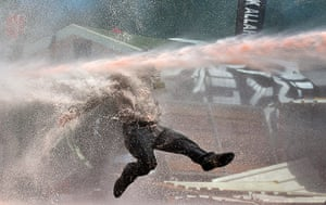 Turkey update: A protestor is hit by a water cannon in Taksim Square