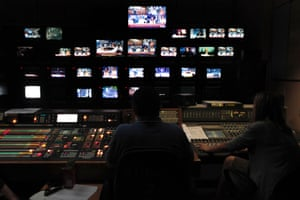 Employees of the Greece state broadcaster ERT in the control room at the television station's headquarters in Athens, on Wednesday, June 12, 2013.