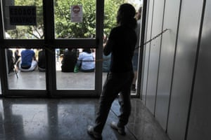 An employee stands inside the  Greek  state broadcaster  headquarters in Athens on June 12, 2013.