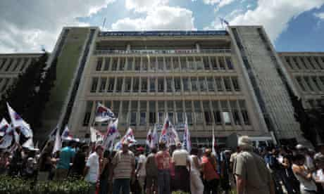 People gather outside the Greece's publi