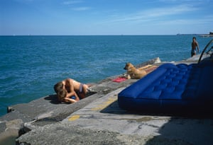 Big Picture - Doug Ischar: men sunbathing on urban beach