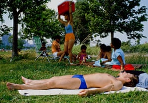 Big Picture - Doug Ischar: man sunbathing with family in background