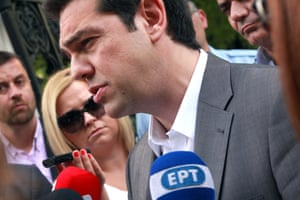 Greece's main opposition leader Alexis Tsipras, talks to the media after his meeting with Greek President Carolos Papoulias in Athens on Wednesday June 12, 201