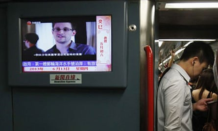 A news bulletin on a Hong Kong train shows Edward Snowden