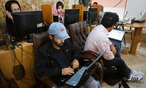 Customers at an internet cafe in Tehran 9/5/11