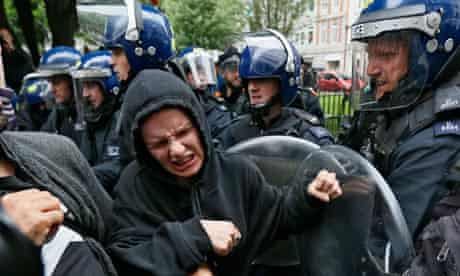 Police officers and activists scuffle prior to the G8 summit in central London