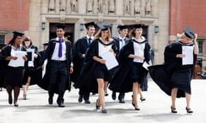 Graduates leave the Great Hall after a degree ceremony at Birmingham University UK