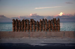 Kiribati, Pacific island: Newly made sandbags sit on a wall on a causeway that connects the town of B