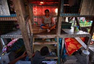 Kiribati, Pacific island: A pregnant woman sits inside her small hut in the village of Betio