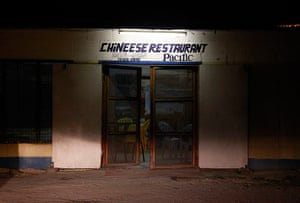 """Kiribati, Pacific island: A sign misspelling the word """"Chinese"""" is seen above the door of a restauran"""