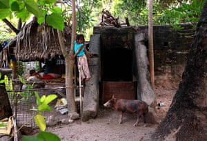 Kiribati, Pacific island: A girl stands on a World War Two Japanese bunker, which is being used as a