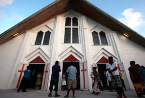Kiribati, Pacific island: Members of the congregation stand outside the church on South Tarawa