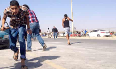 File picture of protesters running for cover after Libya Shield militia opened fire on 8 June
