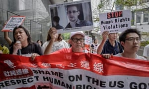 Protesters shout slogans in support of Edward Snowden in Hong Kong