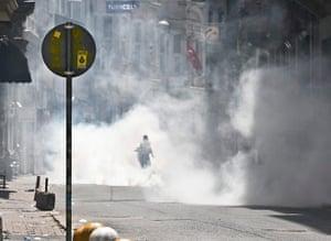 Turkey demonstrations: protestor in tear gas