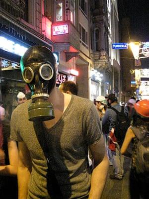 Turkey demonstrations: protestor wears gas mask