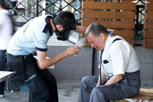 Turkey demonstrations: police washes mans face