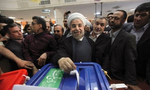 Iranian presidential candidate Hasan Rouhani, the country's former top nuclear negotiator, casts his ballot in the presidential election at a polling station in downtown Tehran, Iran.
