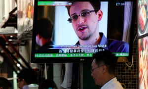 News of Edward Snowden screens at a restaurant in Hong Kong, where he went before NSA scandal broke