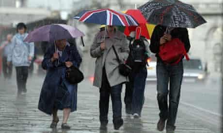 People walk through wind and rain in London