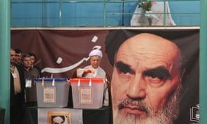 Former Iranian President Akbar Hashemi Rafsanjani votes during the Iranian presidential election in the Jamaran mosque in northern Tehran.