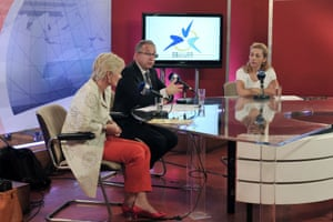 """Jean-Paul Philippot, president of the EBU , the  European Broadcasting Union (C) , EBU'S general director, Ingrid Deltenre(L) and ERT journalist, Ondin Linardatou take part in a live broadcast at the ERT headquarters in Athens on June 14, 2013.  EBU asked  Greece to re-open public broadcaster ERT after the government's surprise decision to pull it off the air in a bid to cut spending sparked a nationwide strike.""""We ask the government to reverse this decision, we ask the government to reestablish the signal on TV, radio and web,"""" said Jean-Paul Philippot, president of the EBU, which aims to promote public-service broadcasting and is the world's largest association of national broadcasters."""