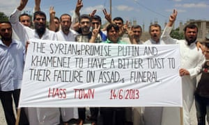 Protesters hold a banner in Idlib, Syria
