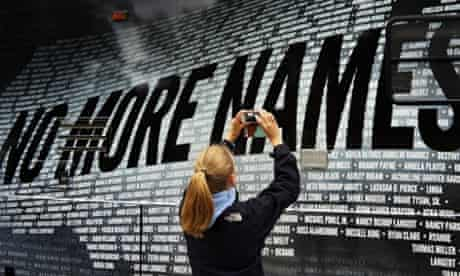 Lindsay Knauf takes a picture of a bus bearing some of the names of over 6,000 people killed by gun violence since the massacre in Newtown at a remembrance event on the six month's anniversary of the massacre at Sandy Hook Elementary School in Newtown, Connecticut.