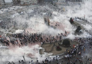 20 Photos: Protesters run as riot police fire teargas at Taksim Square