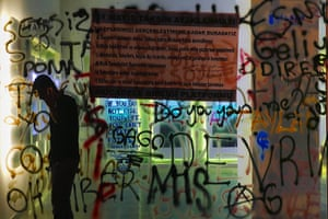 20 Photos: A protester in front of a shop window painted with graffiti in Istanbul