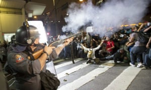 Military police try to disperse protesters in Sao Paulo.