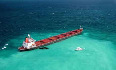 Fuel oil leaks from a Chinese bulk coal carrier grounded on the reef in 2010.