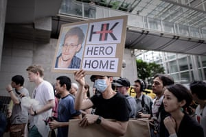 Hong Kong Rally: A protester with a photograph of Edward Snowden at the protest in Hong Kong