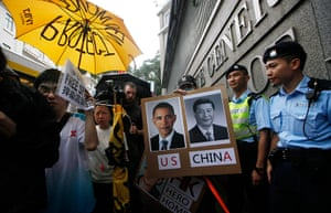 Hong Kong Rally: Supporters of Edward Snowden hold a picture of Barack Obama