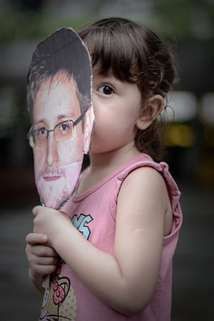 Hong Kong Rally: A child holds a cut out of Edward Snowden during the protest in Hong Kong