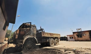 A burned truck is seen at the First Infantry Brigade base in Benghazi