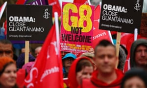 People take part in a demonstration in Belfast against the upcoming G8 summit, to be held near Enniskillen