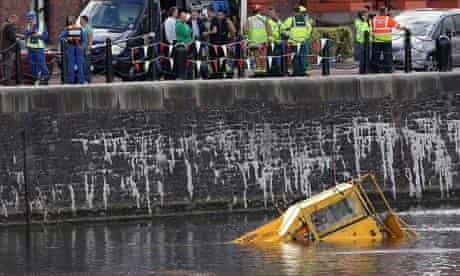 The amphibious tour bus almost submerged in Albert Dock.