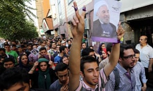 Supporters of Iran's newly-elected president, Hassan Rouhani