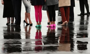Sasha and Malia Obama wear colorful shoes as they are greeted along with President Barack Obama and first lady Michelle Obama upon their arrival on Air Force One in Belfast, Northern Ireland for the G8 summit.