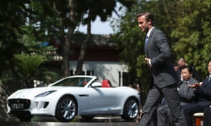 Beckham steps up to make a speech as he donates a Jaguar F-Type car to the China Soong Ching Ling Foundation.